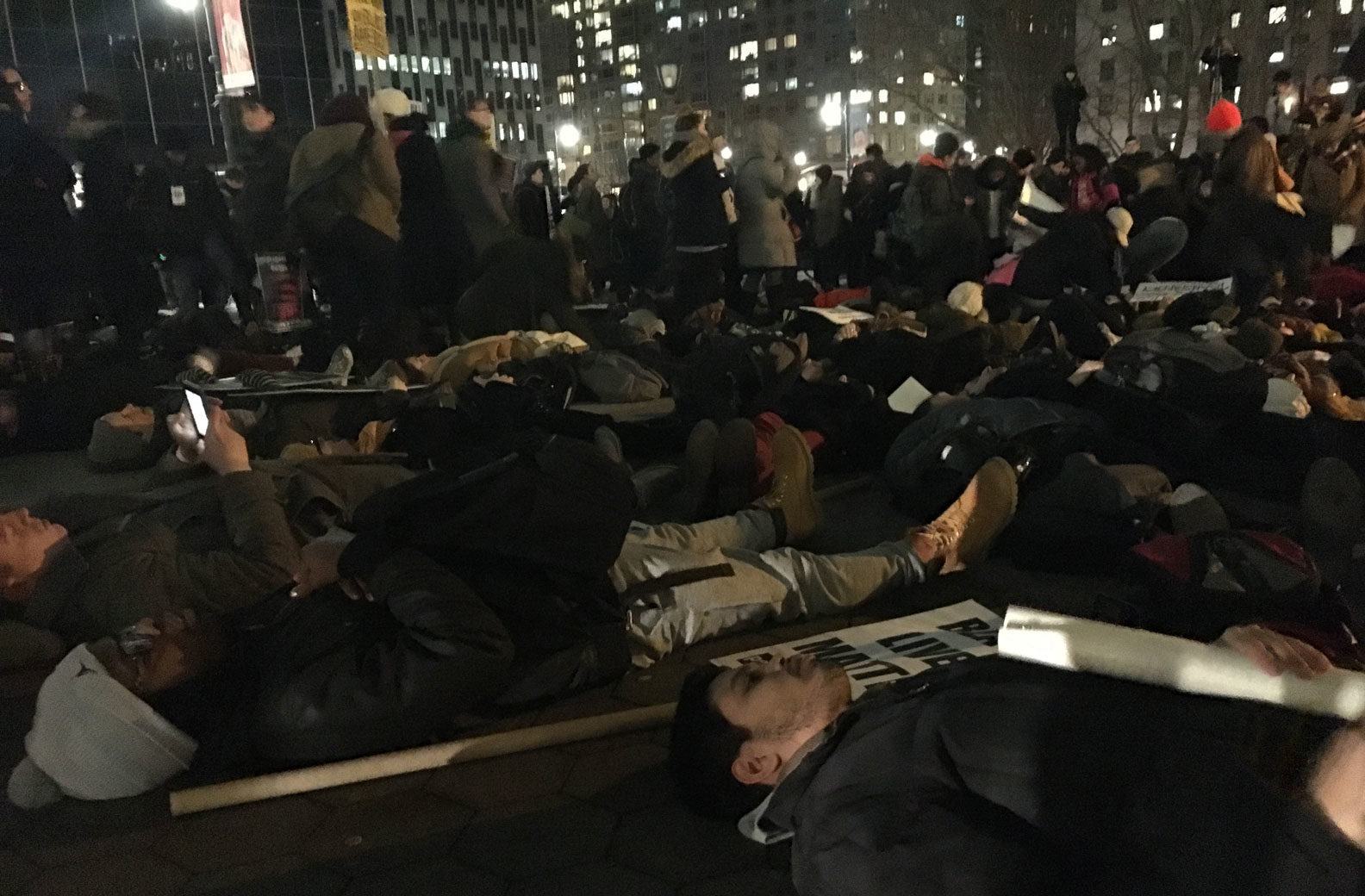 "Protesters participating in a ""die-in"" during the action on Thursday night, Foley Square, Manhattan, February 2, 2017"
