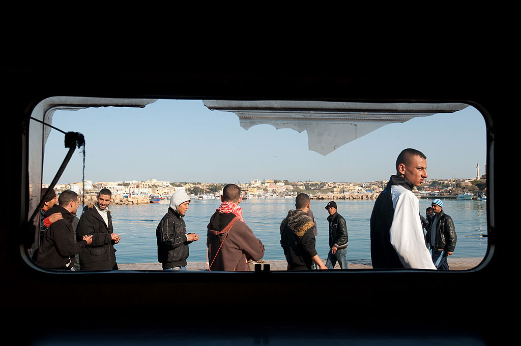 Migrants who have arrived by boat from North Africa at the port in Lampedusa, March, 2011