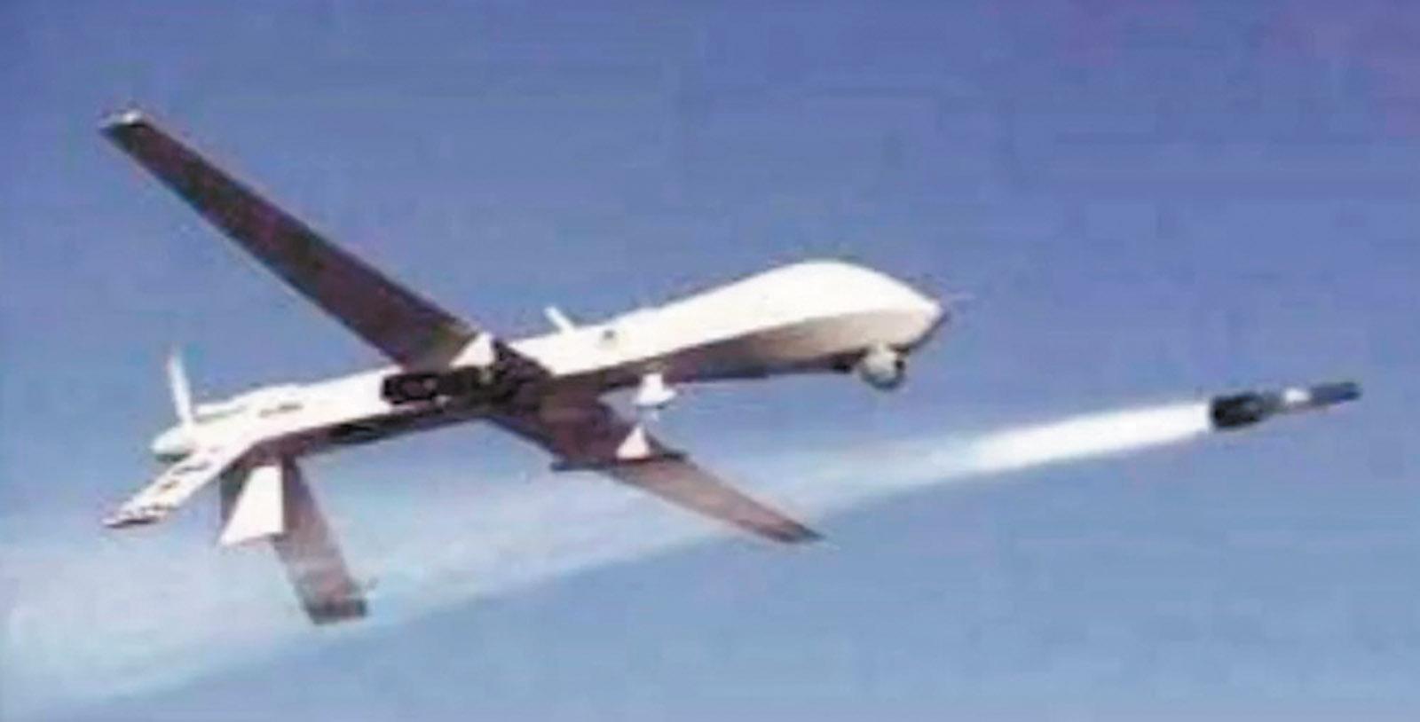 A US Predator drone firing a Hellfire missile