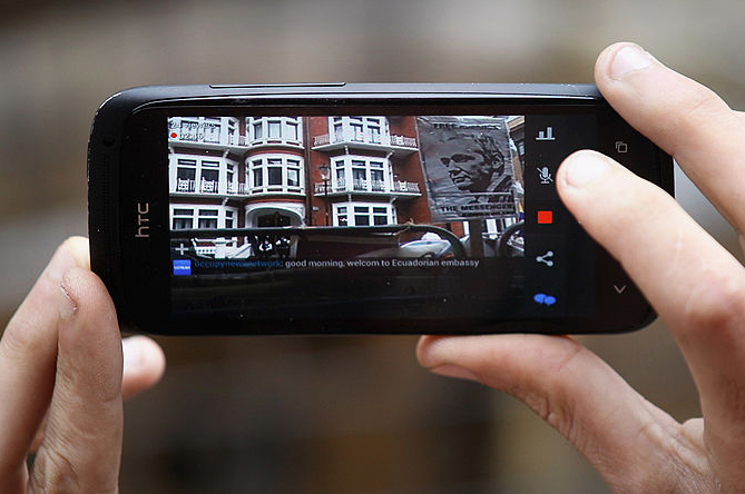 A mobile phone shows the Ecuadorian Embassy where WikiLeaks founder Julian Assange has been living since June 2012, London, England, August 20, 2012