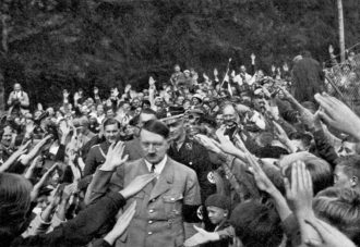 Supporters greeting Adolf Hitler as he arrived at the Berghof, his retreat at Berchtesgaden in the Bavarian Alps, circa 1935
