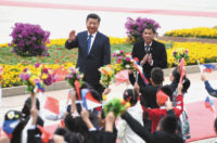 Chinese President Xi Jinping and Philippine President Rodrigo Duterte at a welcoming ceremony before talks in Beijing, during which they agreed to reopen direct discussions on disputes in the South China Sea, October 2016