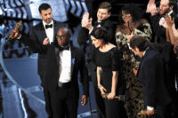 Barry Jenkins, the director of Moonlight, accepting the Oscar for Best Picture with the film's cast and crew, after La La Land was incorrectly announced as the winner, Los Angeles, February 2017