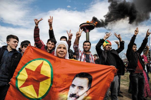 Turkish Kurds with a flag picturing imprisoned PKK leader Abdullah Öcalan, Diyarbakır, March 2015