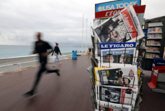 French newspapers with results from France's Presidential election on the Promenade Des Anglais in Nice, France, April 24, 2017
