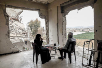 Umm Mohammed and her husband drinking coffee at their destroyed home in the rebel-held town of Douma, on the outskirts of Damascus, March 2017