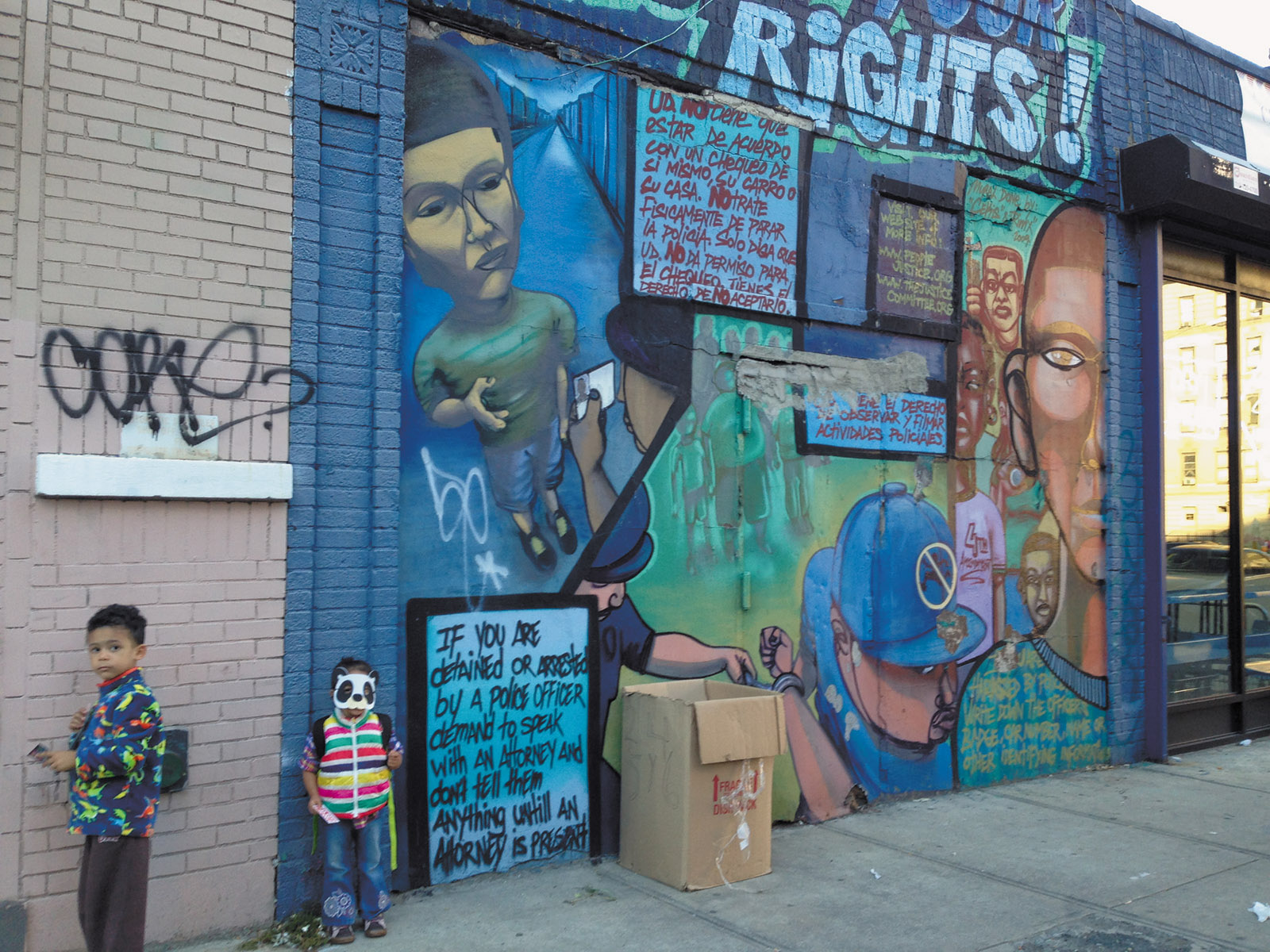'Know Your Rights!'; mural by Nelson Rivas, aka Cekis, Washington Heights, Upper Manhattan. Commissioned in 2009 by the People's Justice for Community Control and Police Accountability, it has since been painted over. 'The mural struck me as an act of love for the people who would pass it by,' Emily Raboteau writes in her essay in The Fire This Time, and 'as a kind of answer to the question that had been troubling us—how to inform our children about the harassment they might face.'