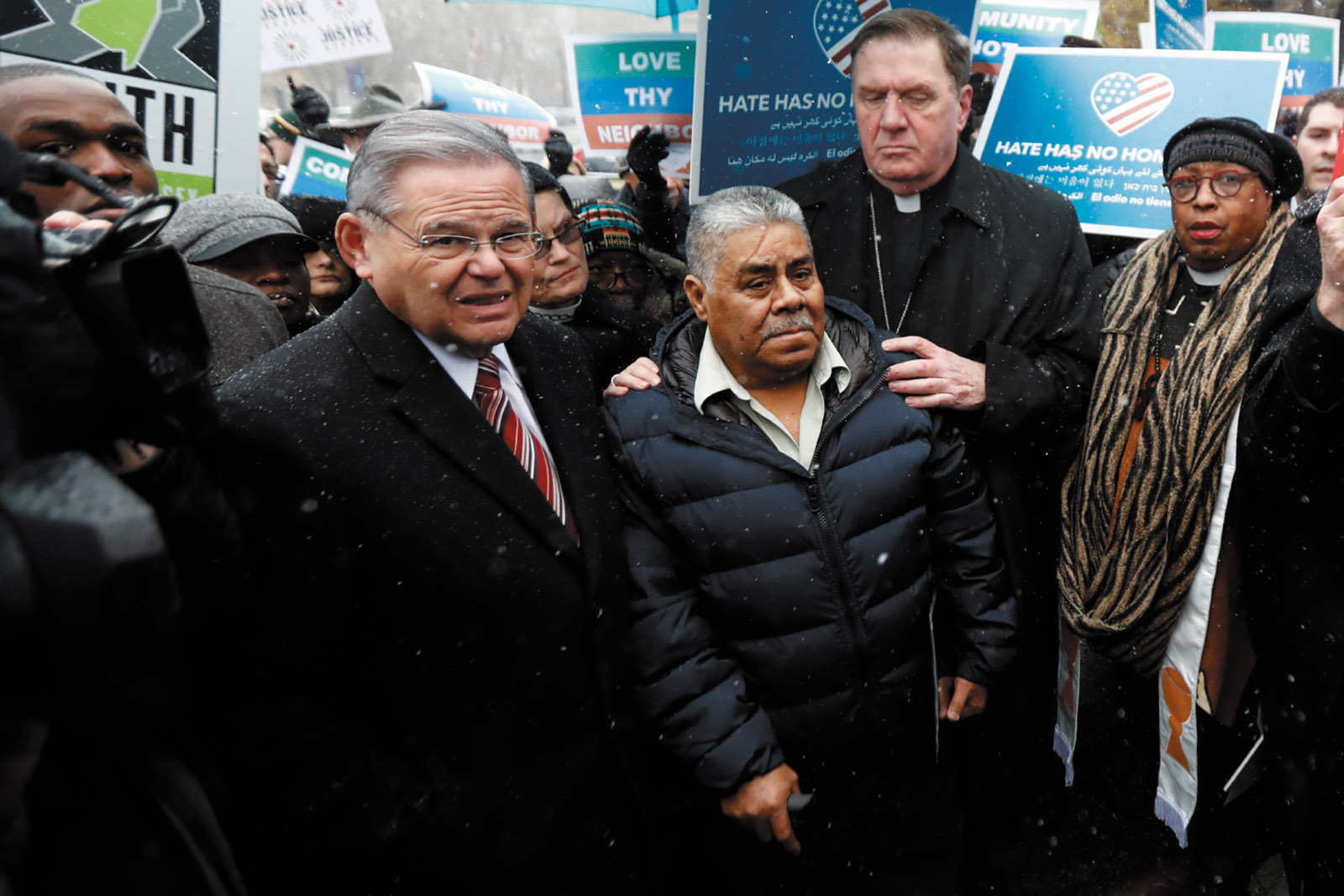 Catalino Guerrero (center), a New Jersey resident who is facing possible deportation to Mexico, with Senator Robert Menendez and Cardinal Joseph Tobin, archbishop of Newark, at a rally before an immigration hearing, Newark, March 2017