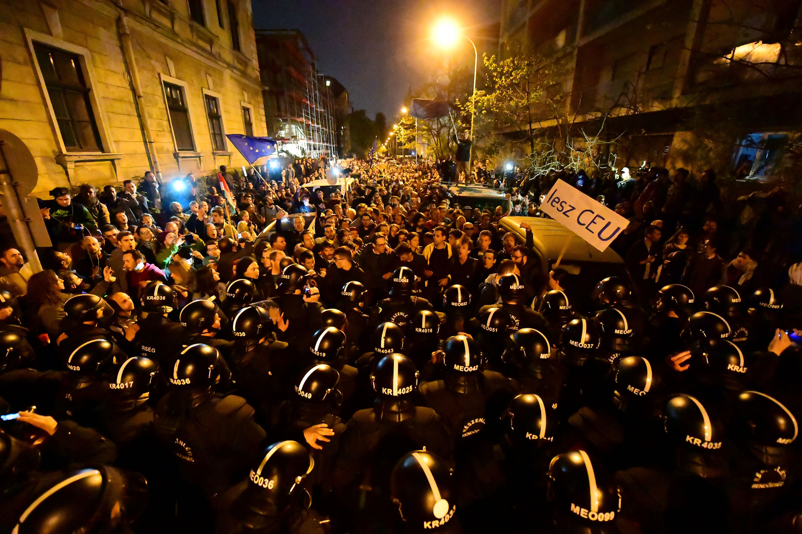 Riot police blocking people protesting the law aiming to close the Central European University (CEU) near the Fidesz Party headquarters, Budapest, April 9, 2017