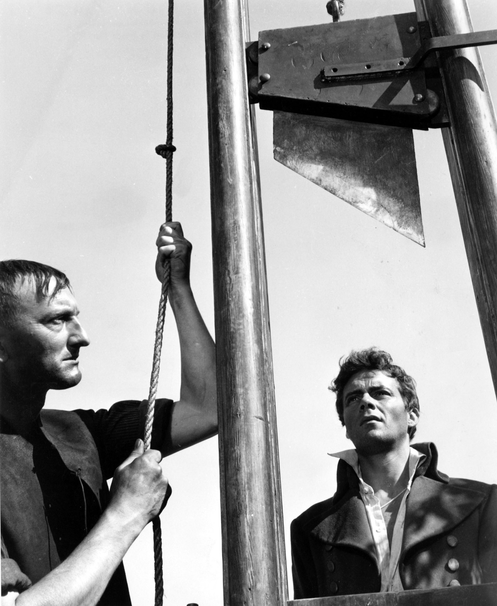Dirk Bogarde (right) as Sydney Carton at the guillotine in A Tale of Two Cities, 1958