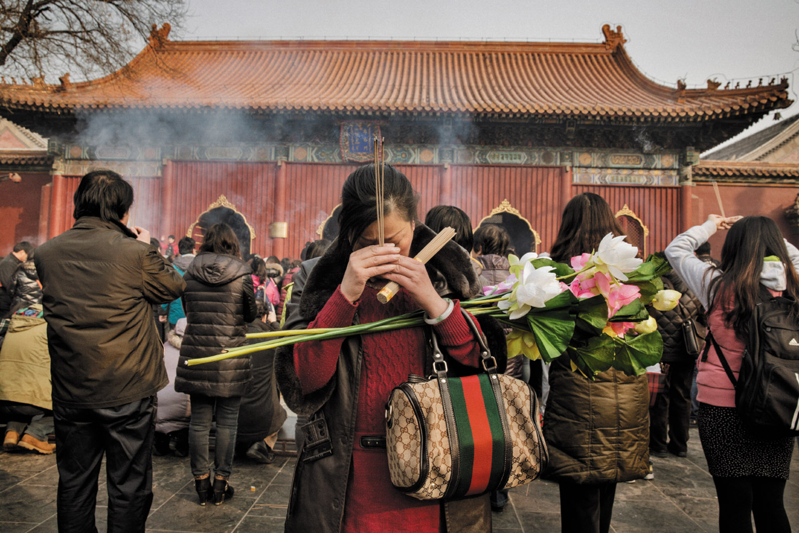 Worshipers at the Tibetan Buddhist Lama Temple in central Beijing, March 2014