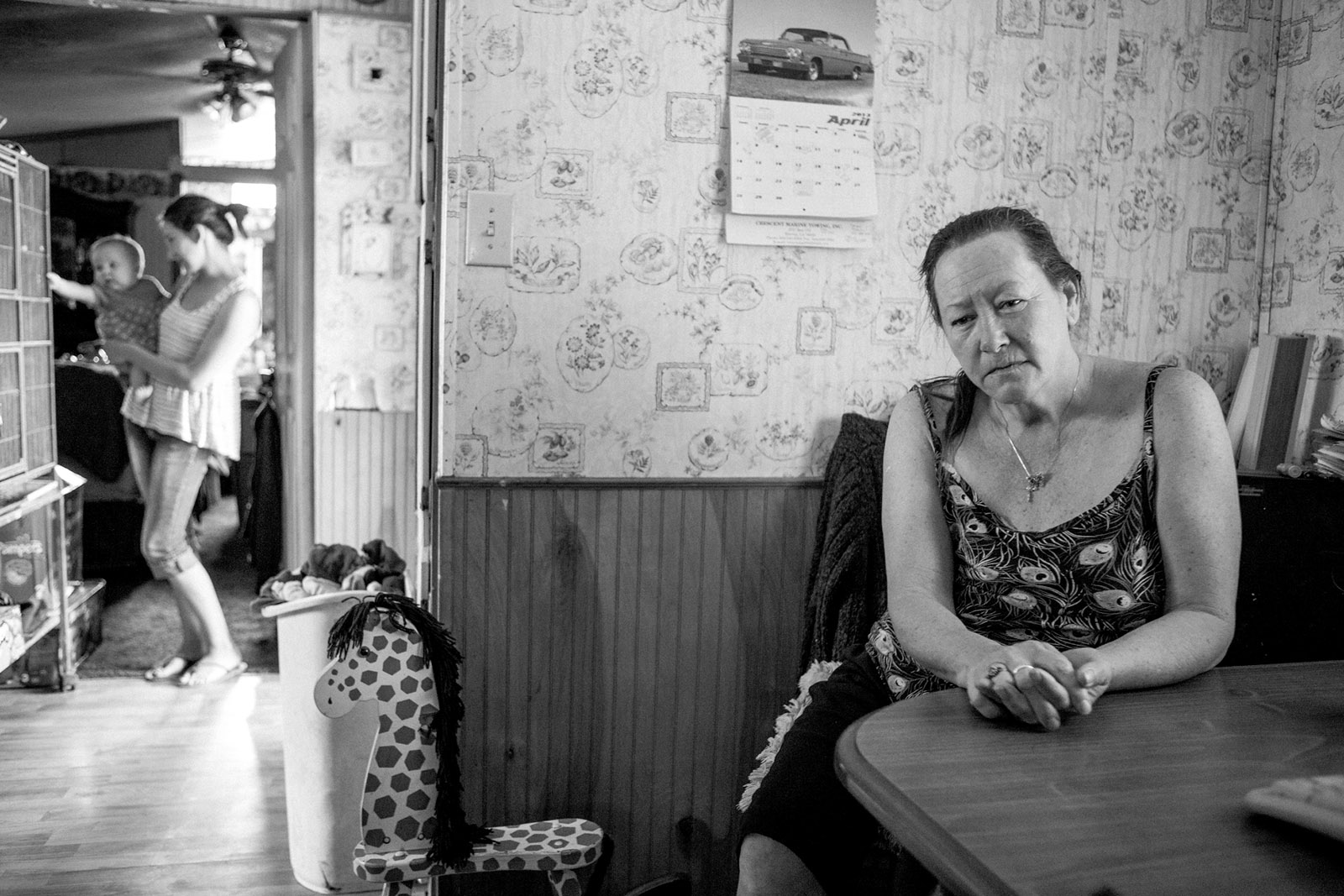 Virginia, who used to have a middle-class income but has been struggling to support herself and five grandchildren on disability benefits and food stamps since debilitating neuropathy took her out of the workforce, rural Louisiana, 2013; photograph by Barbara Grover from 'This Is Hunger,' a multimedia installation created by MAZON that is traveling from state to state by truck through July 2017