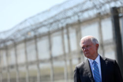 Attorney General Jeff Sessions standing at the secondary border fence between the US and Mexico, San Diego, California, April 21, 2017