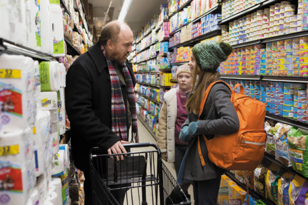 Louis C.K. as Louie and Ursula Parker and Hadley Delany as his daughters Jane and Lilly in season 5 of <i>Louie</i>, 2015