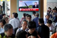 News of North Korea's intercontinental ballistic missile on a television screen at a railway station in Seoul, July 4, 2017