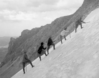 Hikers ascending Tyndall Glacier in Rocky Mountain National Park, Colorado, circa 1920