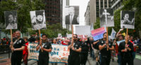 Marchers with photos of anti-gay activist Anita Bryant, Chechen President Ramzan Kadyrov, Donald Trump, the KKK, and Adolf Hitler at the Pride Parade, San Francisco, June 25, 2017