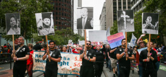 Marchers with photos of anti-gay activist Anita Bryant, Chechen President Ramzan Kadyrov, Donald Trump, the KKK, and Adolf Hitler at the Pride Parade, San Francisco, June 25, 2017
