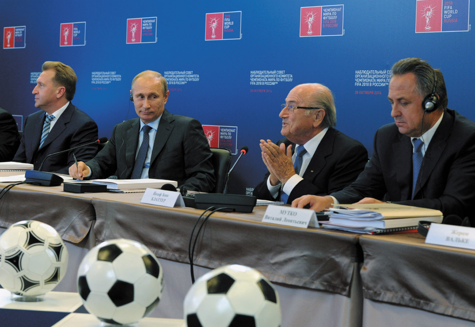 Mikhail Klimentyev/RIA Novosti/Kremlin/Reuters Russian President Vladimir Putin and FIFA President Sepp Blatter discussing the 2018 World Cup, Moscow, October 2014. At left is Russian Deputy Prime Minister Igor Shuvalov; at right is Russian Sports Minister Vitaly Mutko.
