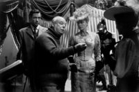 Jean Renoir with Mel Ferrer and Ingrid Bergman on the set of Elena and Her Men, 1956