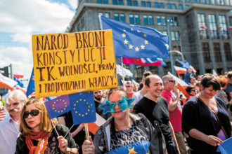 Pro-EU protesters at a demonstration against Poland's right-wing government, Warsaw, May 2016. The sign says, 'The people defend the Constitution as well as freedom, laws, and the threefold form of government.'