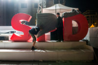 Stage crew members covering the Social Democratic Party of Germany (SPD) logo after a campaign event, Gendarmenmarkt Square, Berlin, September 22, 2017
