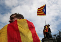 People wave a Catalan separatist flag after the banned independence referendum in Barcelona, October 2, 2017