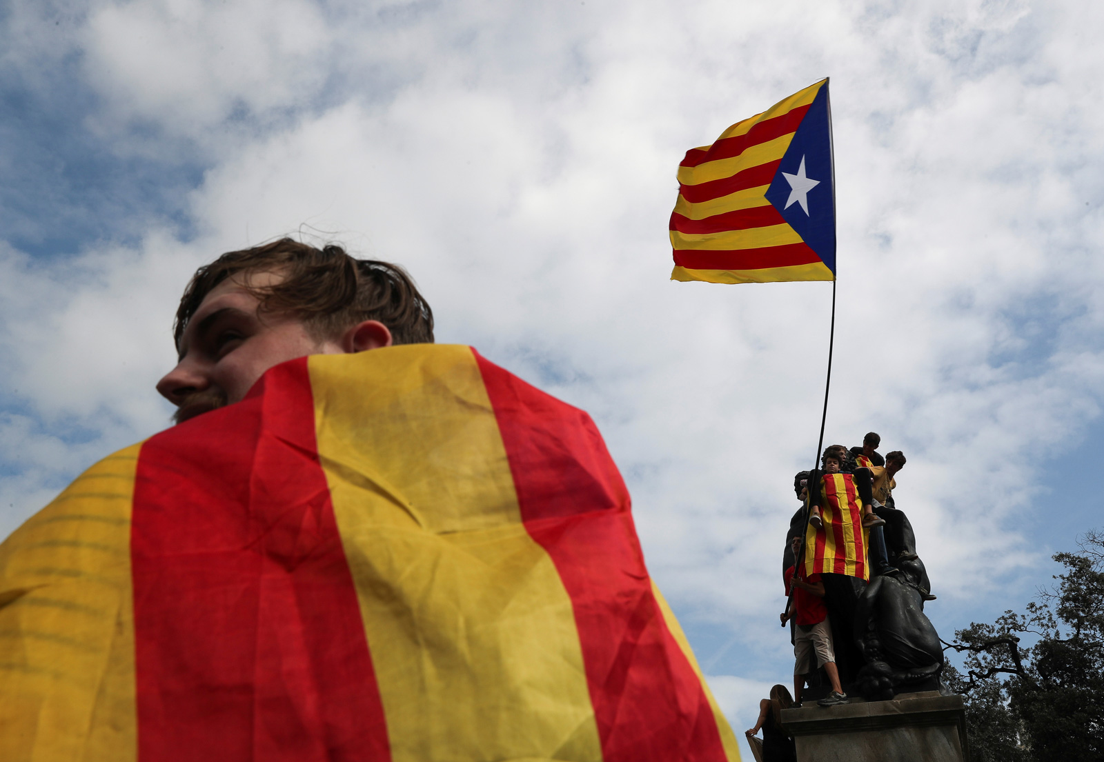 People wave a Catalan separatist flag after the banned independence referendum in Barcelona, October 2, 2017