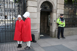 Reproductive rights activists, dressed as Handmaids from Margaret Atwood's The Handmaid's Tale, outside the Irish parliament before deliberation about the constitutional ban on abortion, September 18, 2017