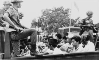 Indonesian soldiers taking suspected Communists to prison during a military crackdown in which some 500,000 Indonesians were killed, Jakarta, October 30, 1965