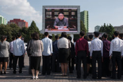 North Koreans watching a news broadcast of their leader, Kim Jong-un, speaking about the country's nuclear program, Pyongyang, September 22, 2017