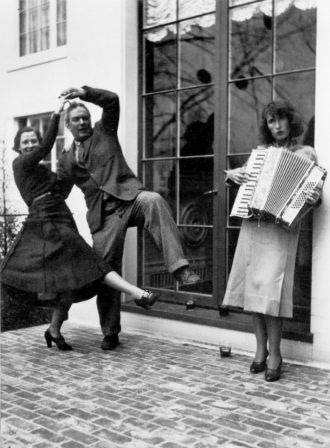Alexander Calder and Margaret French dancing while Louisa Calder plays the accordion, Farmington, Connecticut, 1936