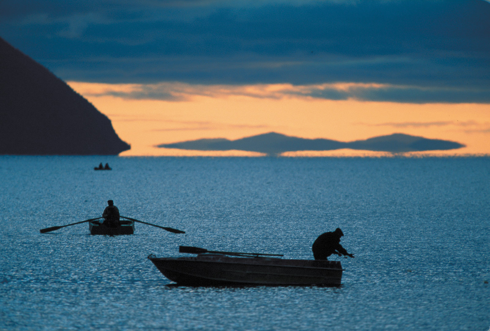 Fishermen on the Okhotsk Sea, at the mouth of the Amur River, which separates Russia and China