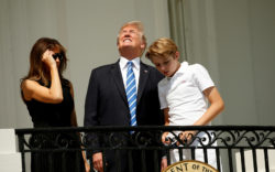 President Donald Trump looking at the solar eclipse without protective glasses, with his wife Melania and son Barron at the White House, Washington, D.C.,  August 21, 2017