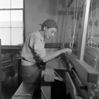 Photograph by Helen M. Post of Anni Albers in her weaving studio at Black Mountain College, 1937