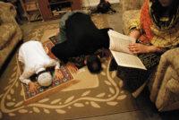 A Muslim family praying, Rockwood, Minnesota, 2003