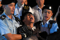 Democracy activist Joshua Wong during his arrest at a protest in Hong Kong the day before a visit from Chinese president Xi Jinping, June 2017
