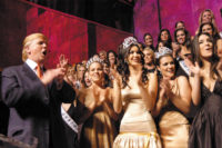 Donald Trump with Allie LaForce (Miss Teen USA), Natalie Glebova (Miss Universe), and Chelsea Cooley (Miss USA) at a launch party for Cara Birnbaum's book Universal Beauty: The Miss Universe Guide to Beauty, Trump Tower, New York City, April 2006