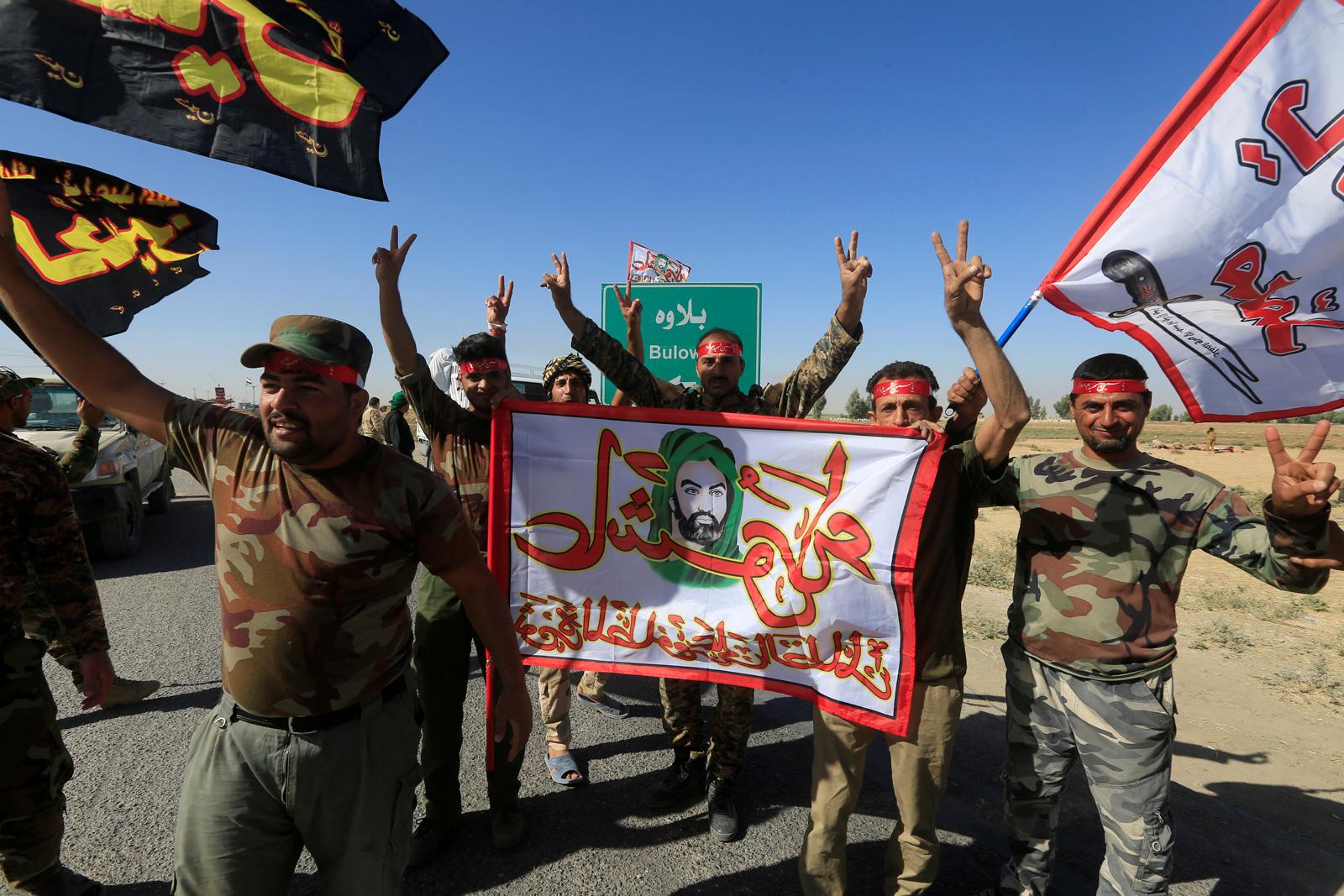 Shiite militiamen celebrating their advance into Kurdish-held Iraqi territory near Kirkuk, October 17, 2017