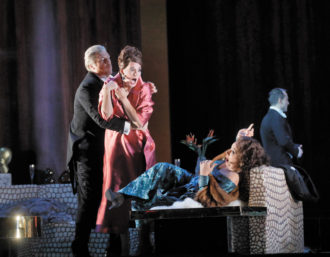 Rod Gilfry as Alberto Roc, Amanda Echalaz as Lucía de Nobile, and Christine Rice as Blanca Delgado in Thomas Adès's The Exterminating Angel