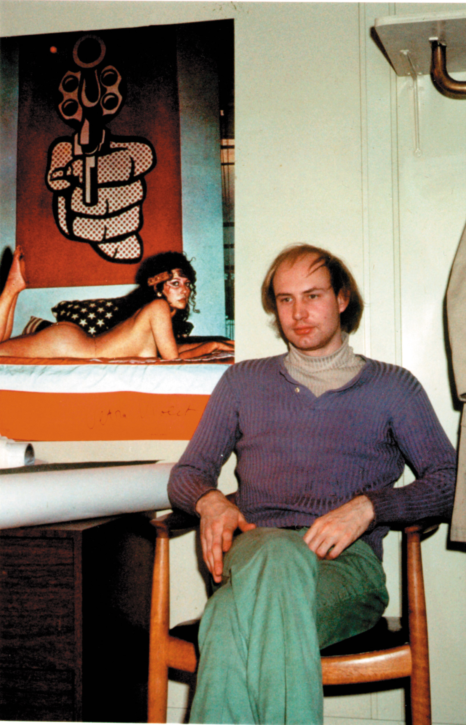 Douglas Crimp in his office at the Solomon R. Guggenheim Museum, New York City, circa 1970. The actress known as Ultra Violet, a regular at Andy Warhol's Factory, appears in the poster behind him.