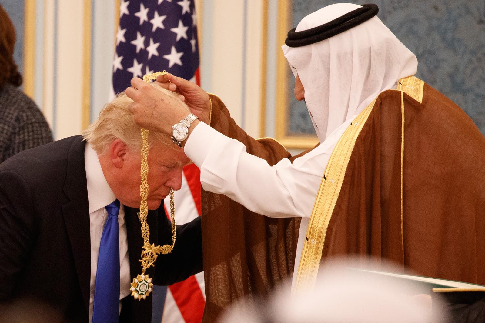 Saudi King Salman presenting President Donald Trump with the highest civilian honor, the Collar of Abdulaziz Al Saud, at the Royal Court Palace, Riyadh, Saudi Arabia, May 20, 2017