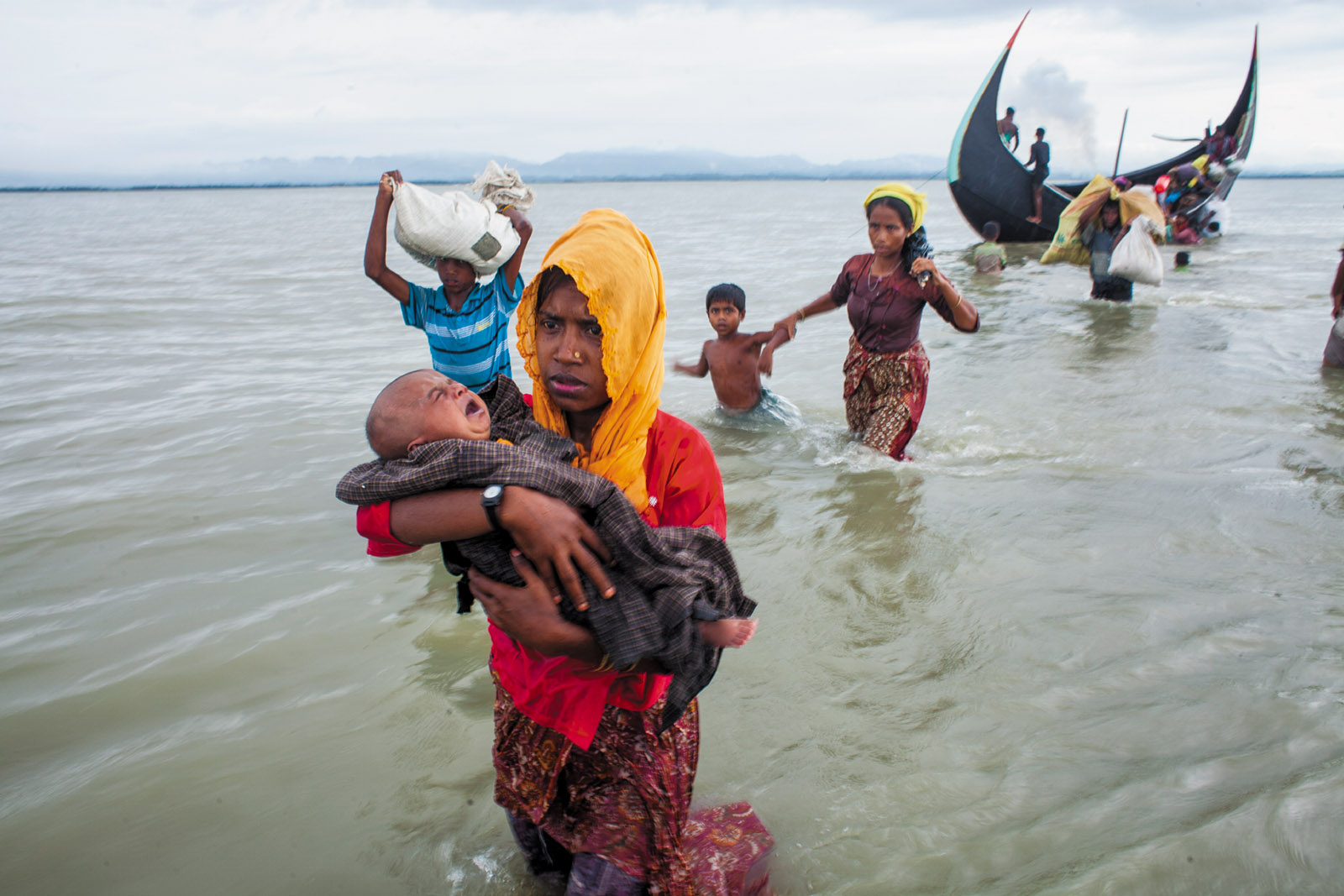 Rohingyas fleeing across the Naf River from Myanmar into Bangladesh, September 2017