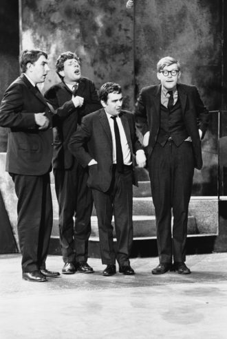 Peter Cook, Jonathan Miller, Dudley Moore, and Alan Bennett performing in Beyond the Fringe, 1964