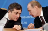 Vladislav Surkov conferring with Vladimir Putin, then prime minister, in Kurgan, Russia, 2012