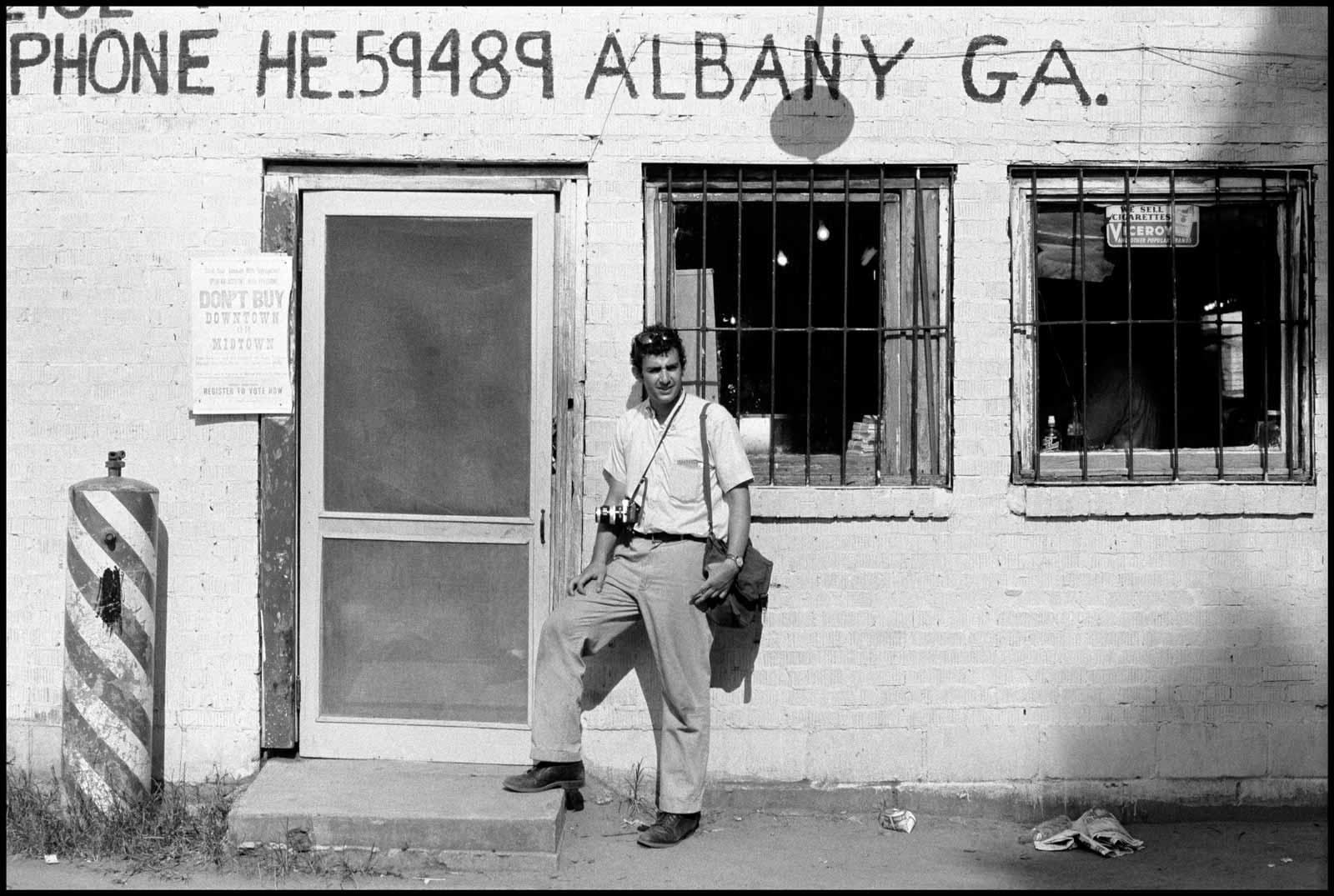 Danny Lyon outside a barbershop and SNCC office, Atlanta, Georgia, 1962