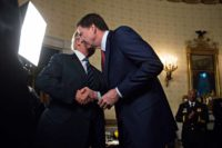 President Donald Trump shaking hands with James Comey, former  FBI Director at the White House, Washington, D.C., January 22, 2017