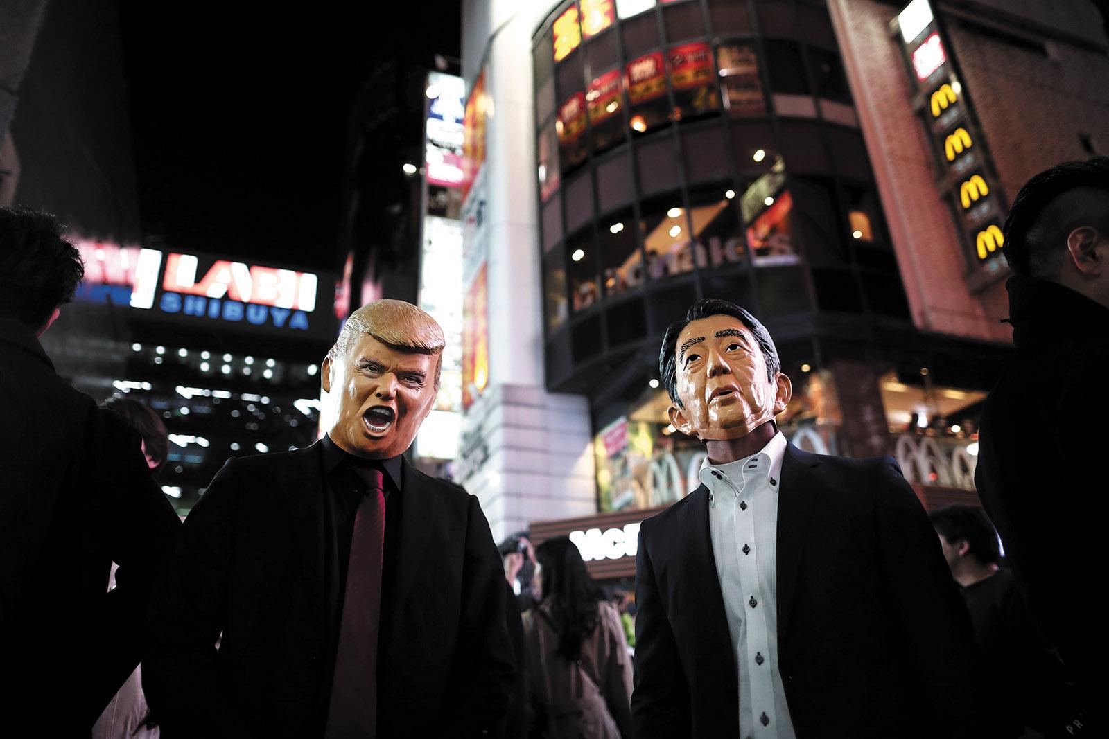 Masks of Donald Trump and Shinzo Abe worn at a Halloween parade in Tokyo, October 2017