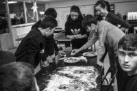 Young refugees baking Christmas cookies with Swedish volunteers at a transit center for unaccompanied asylum seekers in Malmö, Sweden, 2015