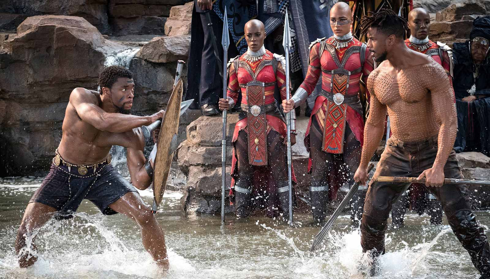 Chadwick Boseman as T'Challa and Michael B. Jordan as Erik Killmonger, with members of the Dora Milaje special forces behind them, from Ryan Coogler's Black Panther, 2018